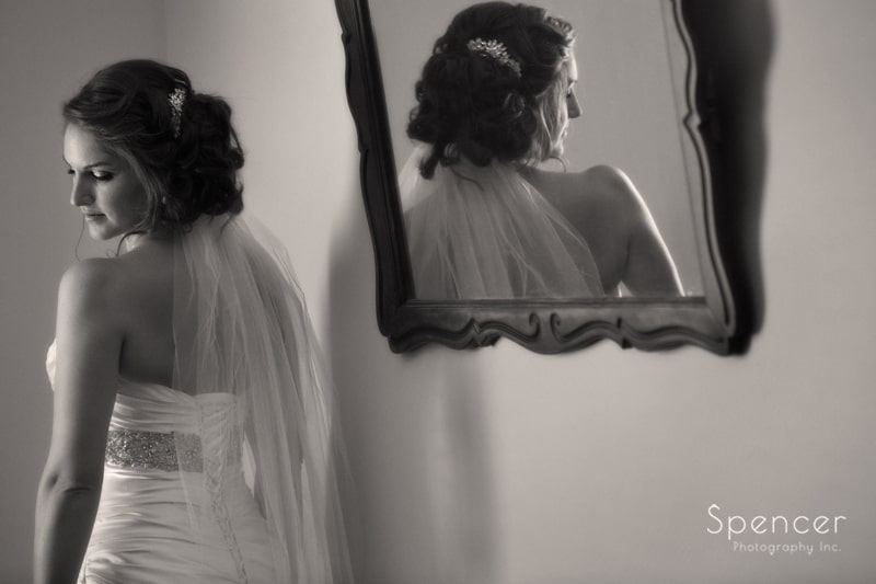 wedding picture of bride in reflection of mirror