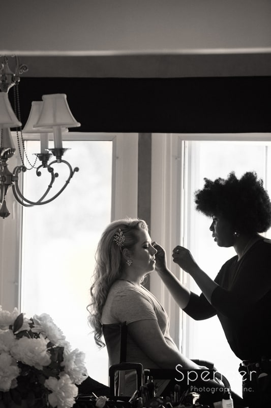 bride getting wedding day make up
