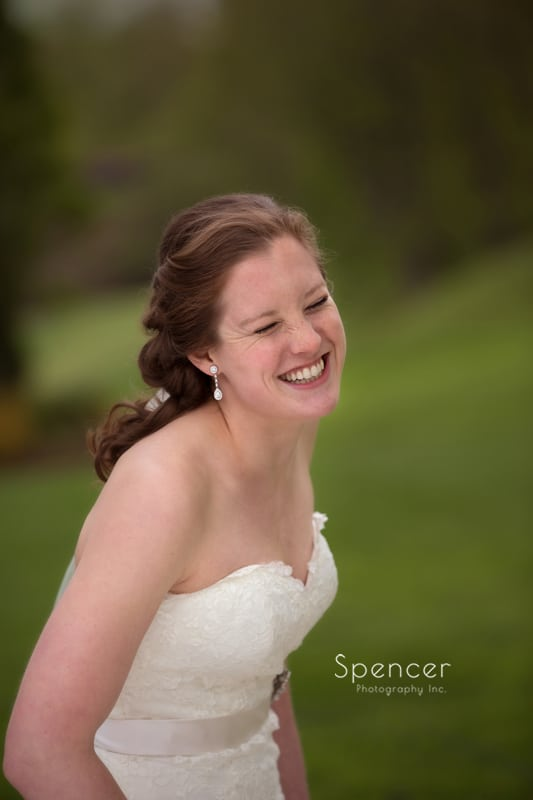 bride laughing on grounds of Mayfield Country Club