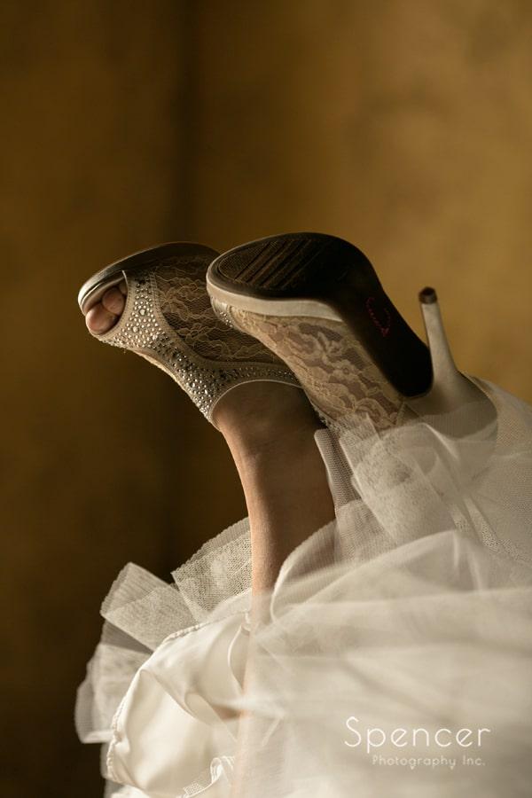 detail wedding picture of brides shoes in suite at Gervasi Vineyard