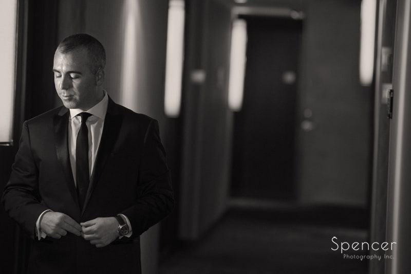 wedding day picture of groom in hallway of Westin Cleveland