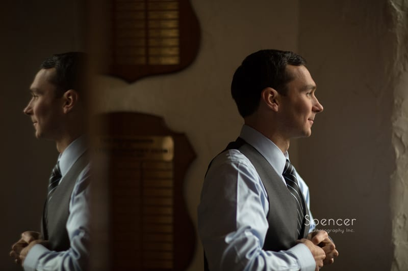groom dressing for his wedding at Mayfield Country Club
