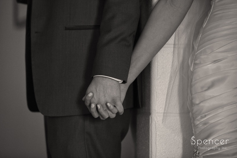 bride and groom holding hands before wedding day in Canton