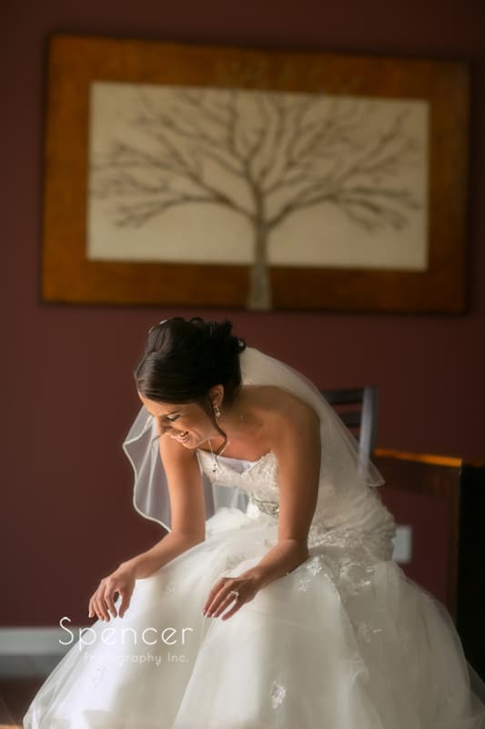 wedding picture of bride cracking up