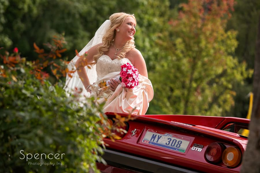 bride laughing next to Ferrari at Gervasi Vineyard