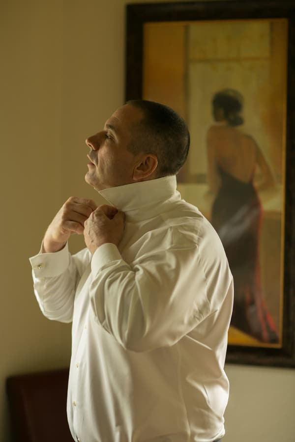 groom getting ready for wedding at Gervasi