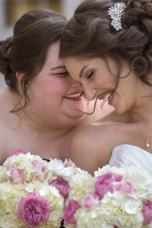 picture of bride and maid of honor laughing