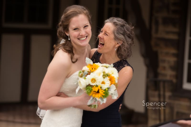 bride laughing with her mom at Mayfield