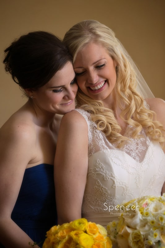 maid of honor hugging bride