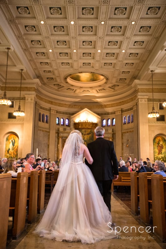 bride and dad walking aisle at cleveland wedding ceremony
