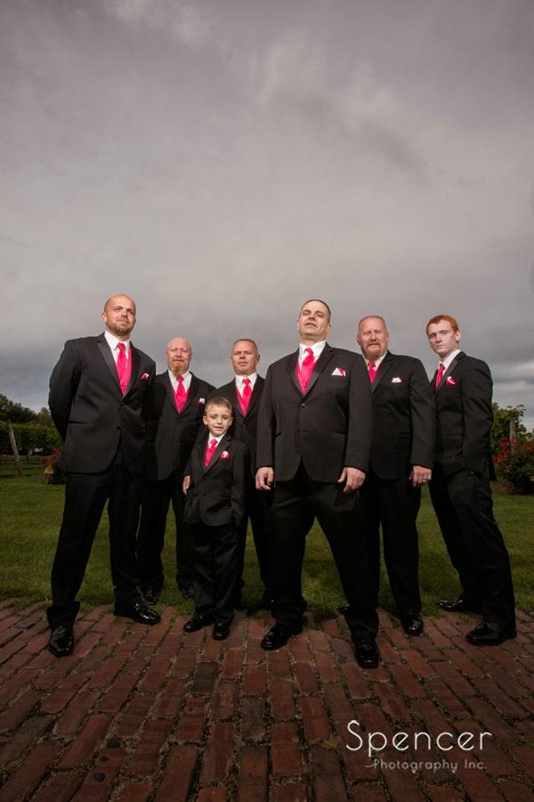 dramatic wedding picture of groomsmen at Gervasi Vineyard