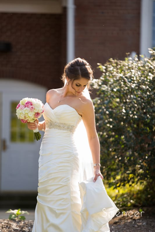 wedding picture of bride in front of Canton church