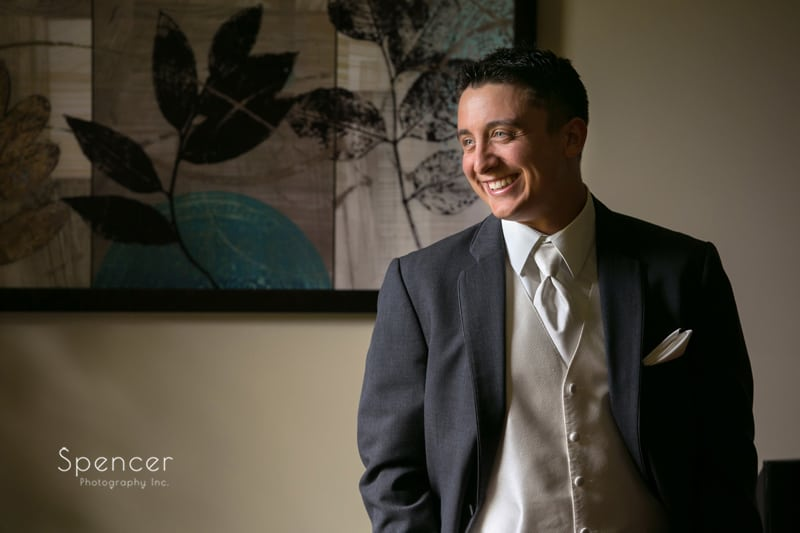 wedding picture of groom laughing