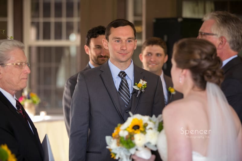 groom looking at bride during Mayfield Country Club wedding ceremony
