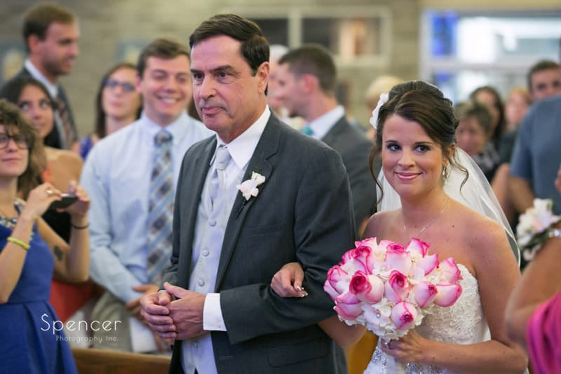 bride and dad walking down aisle at st joseph and john catholic church wedding ceremony
