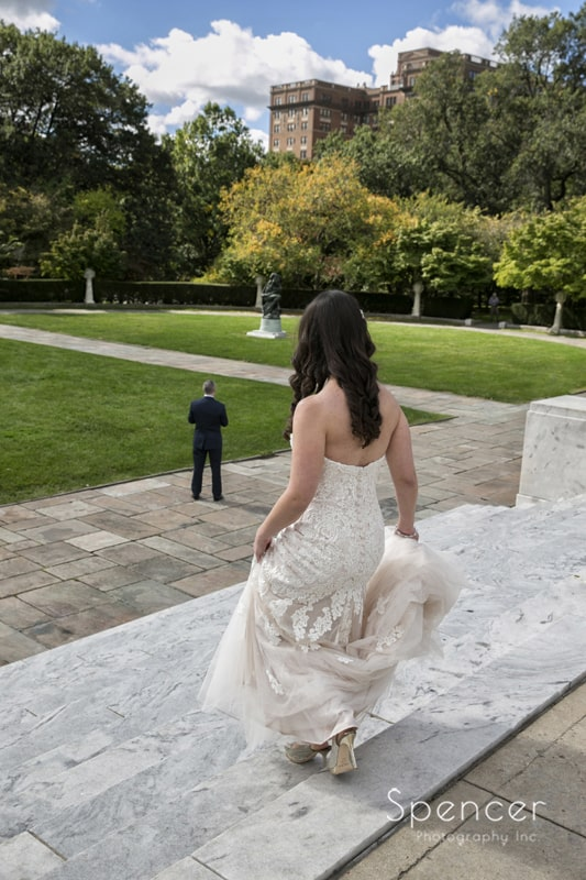 bride walking down steps at wade oval park