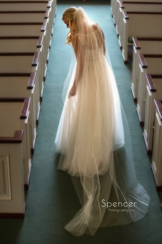 creative wedding picture of bride in Chagrin Falls church
