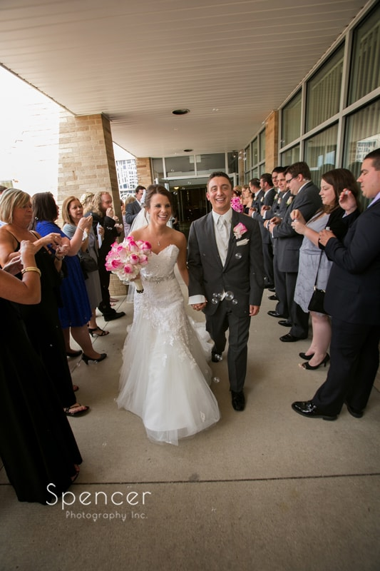 couple walk out of their wedding ceremony at st joseph and john catholic church