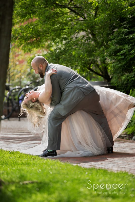 groom dips bride after wedding in chagrin falls ohio