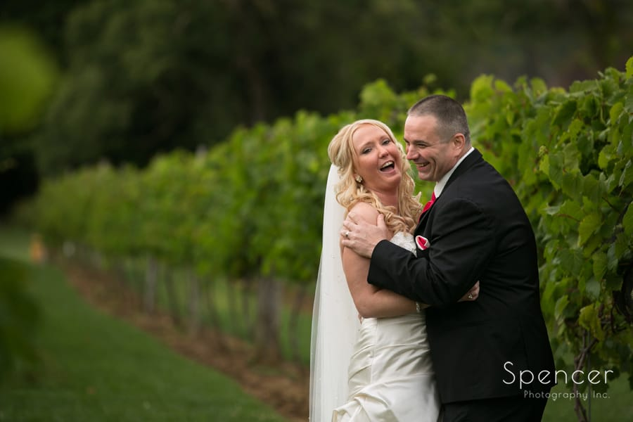 bride and groom laughing after their wedding at Gervasi
