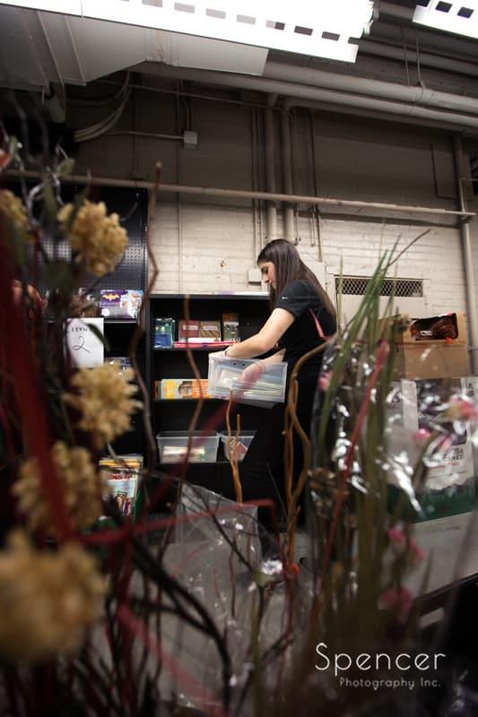 Cleveland ILEA member organizing shelf