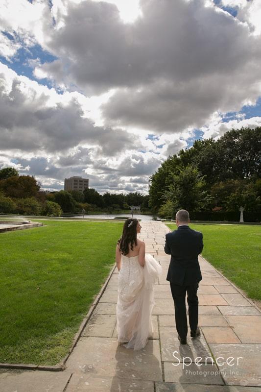 bride and groom walking thru wade oval park cleveland