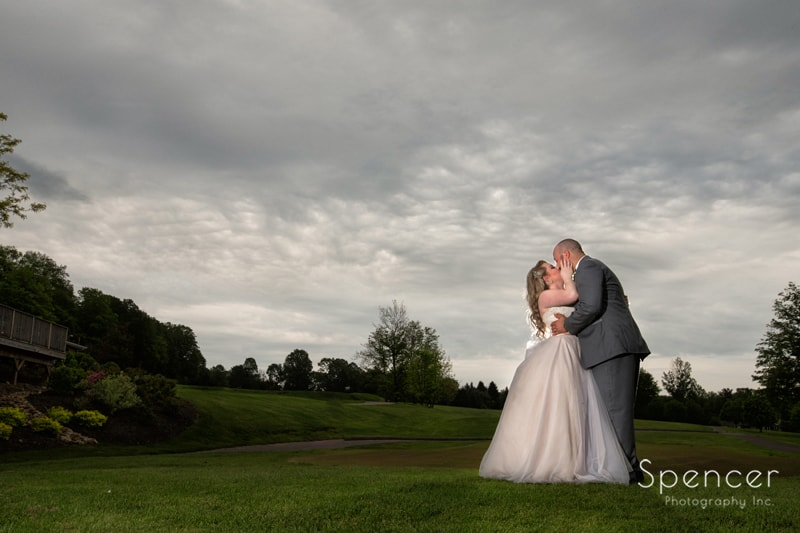 dramatic wedding picture with clouds at tanglewood country club