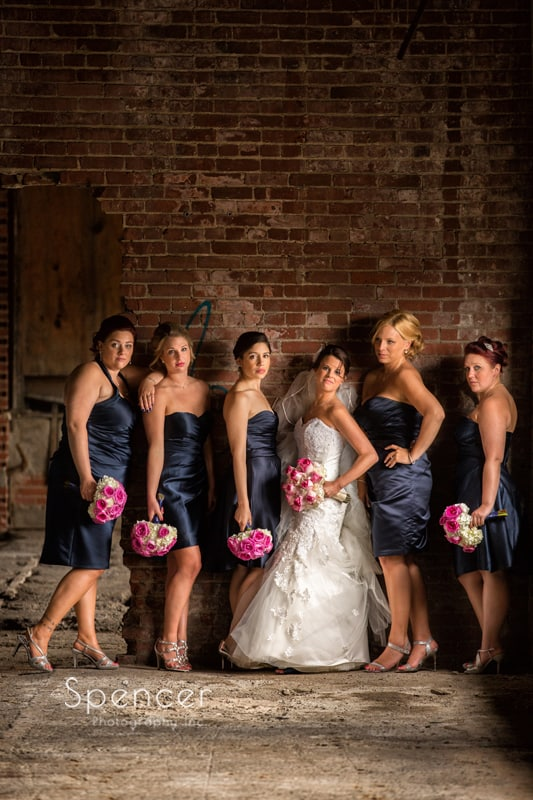 bridesmaids with bride in brick warehouse in cleveland