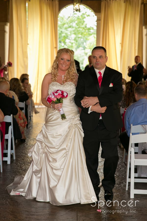 bride and groom walk recessional at Gervasi Vineyard wedding ceremony