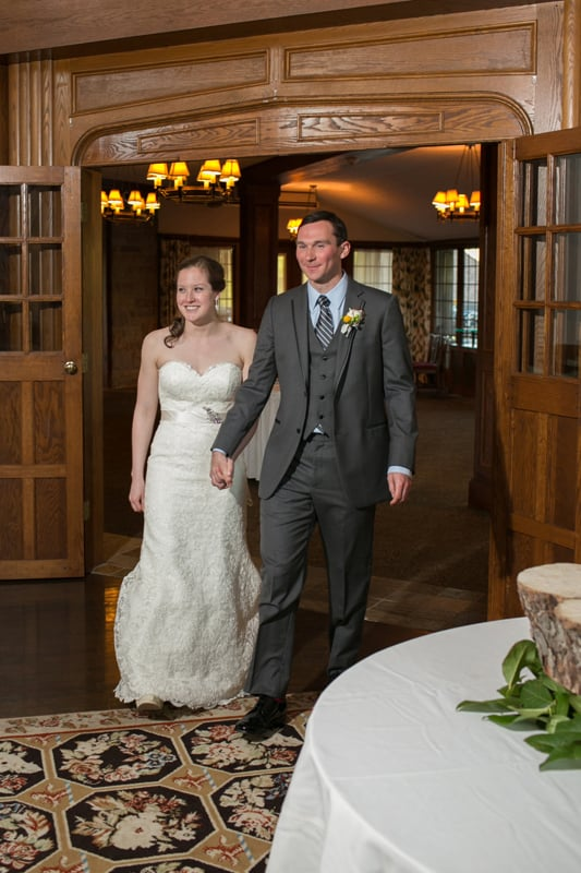 Bride And Groom Walking Into Their Wedding Reception At Mayfield Country Club