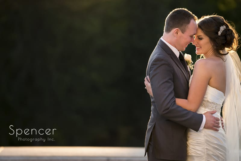 bride and groom share a moment in wedding picture at McKinley Monument