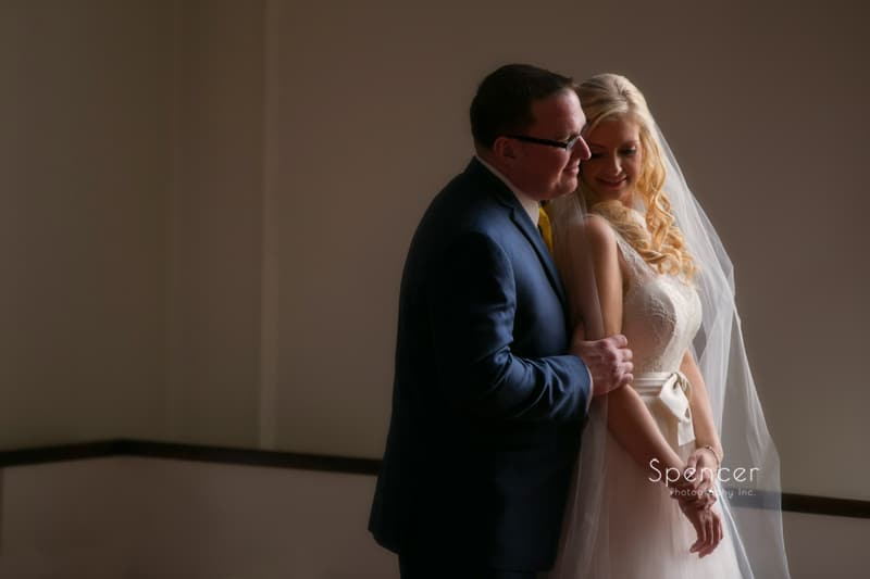 groom whispering to bride after chagrin falls wedding