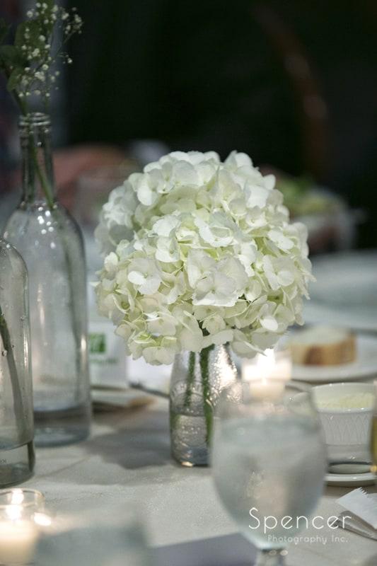 floral centerpiece at La Pizzara wedding reception