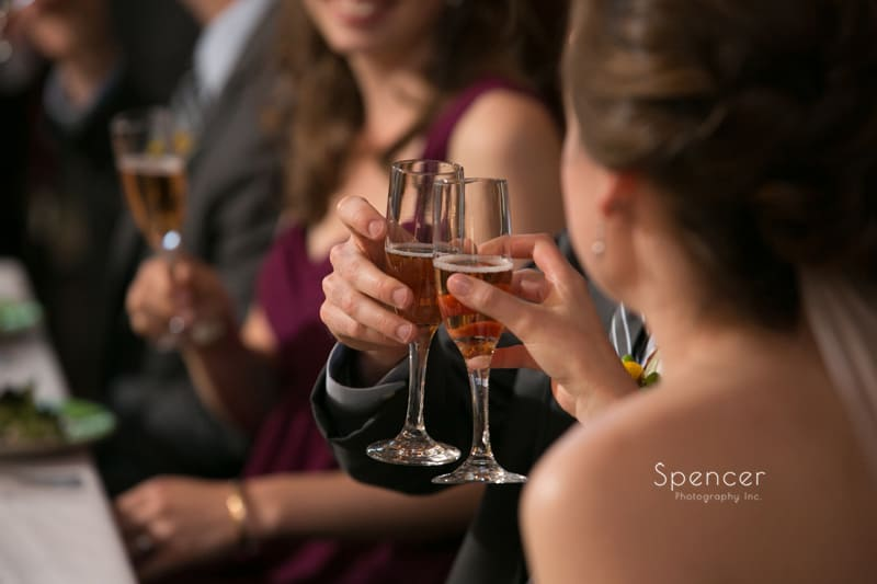 bride and groom toast at their wedding reception at Mayfield Country Club
