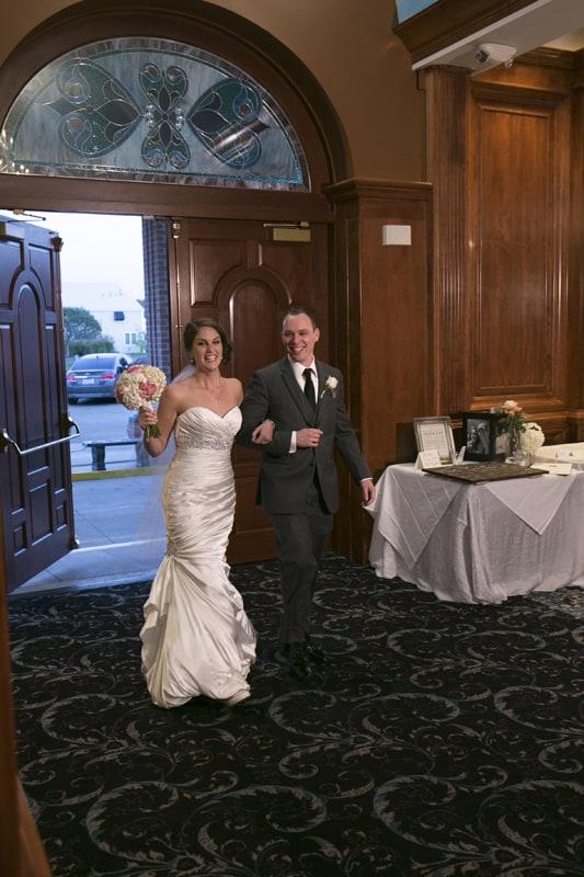 bride and groom enter their wedding reception at La Pizzaria