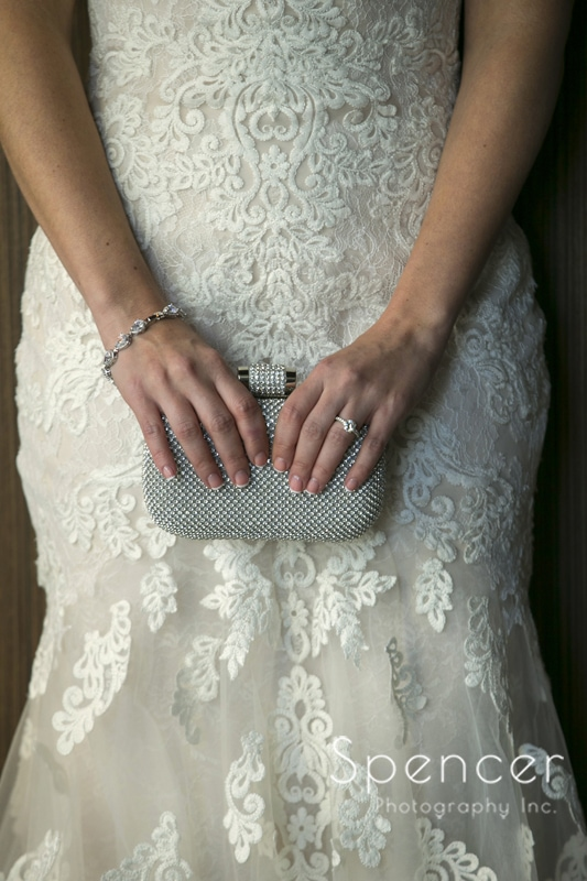 wedding detail picture of dress and clutch
