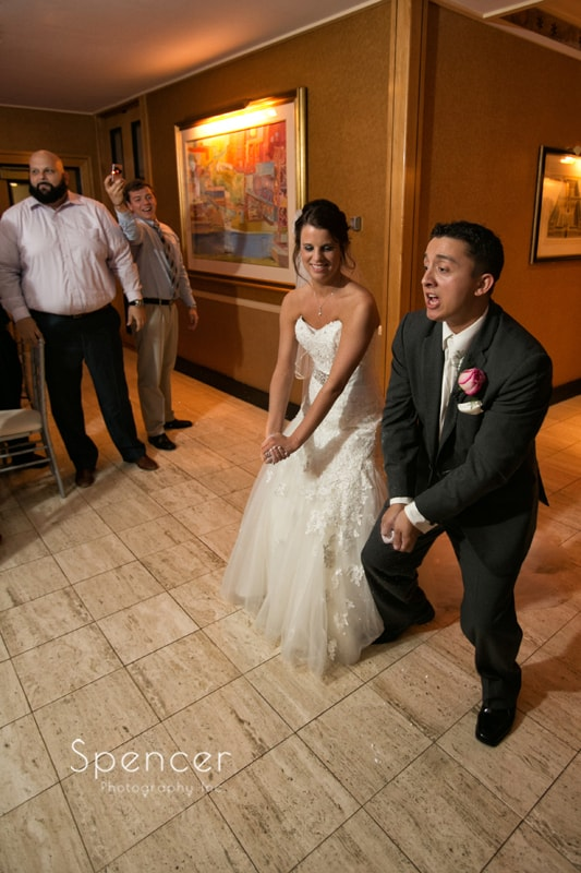 bride and groom enter wedding reception at st. clair ballroom