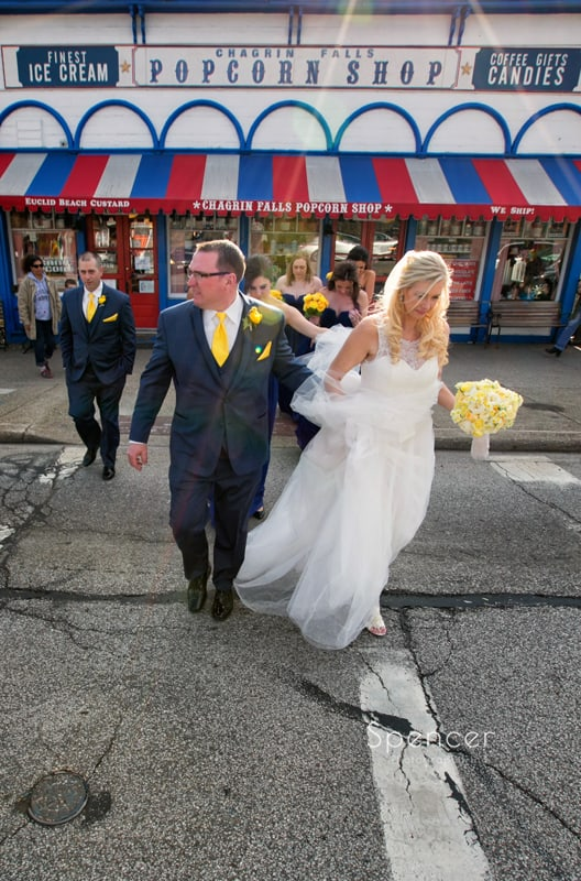 bride and groom crossing street for wedding pictures in Chagrin Falls