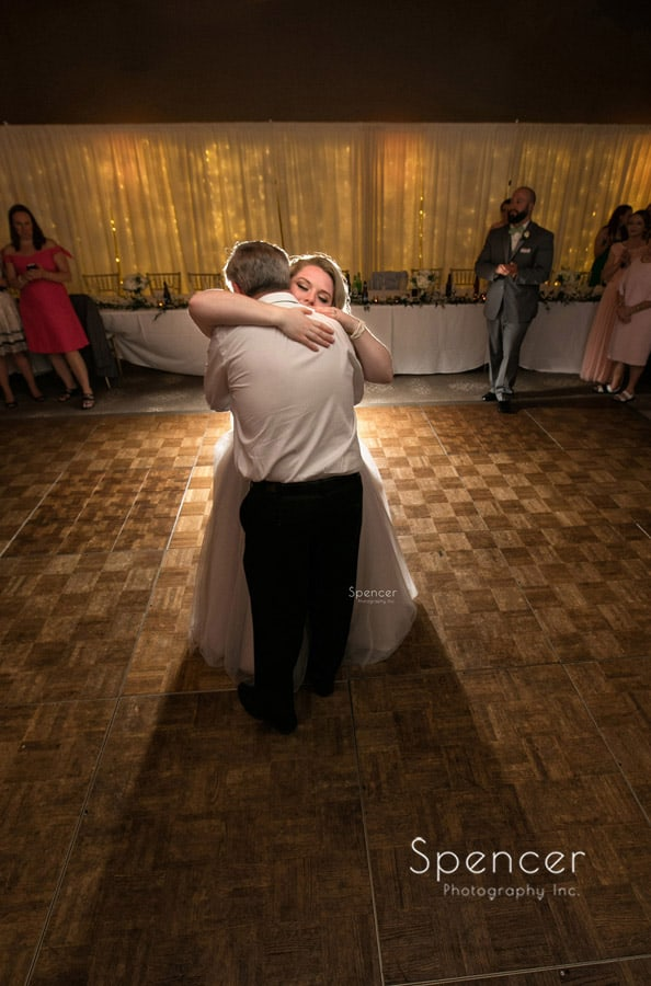 bride hugs dad after first dance in cleveland reception