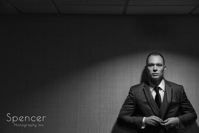 groom posing for picture at Canton Holiday Inn