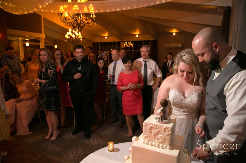 cutting wedding cake at tanglewood wedding reception