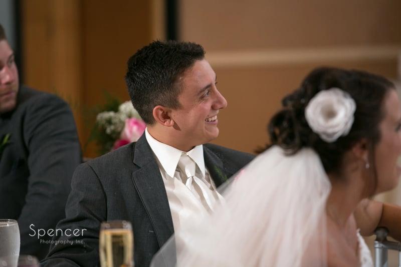 groom reacting to best man speech at reception at st. clair ballroom