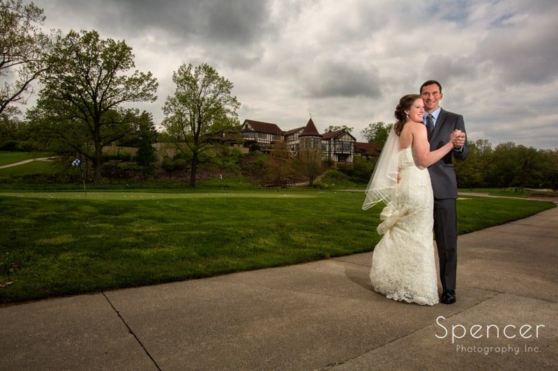 bride and groom standing on grounds of Mayfield Country Club