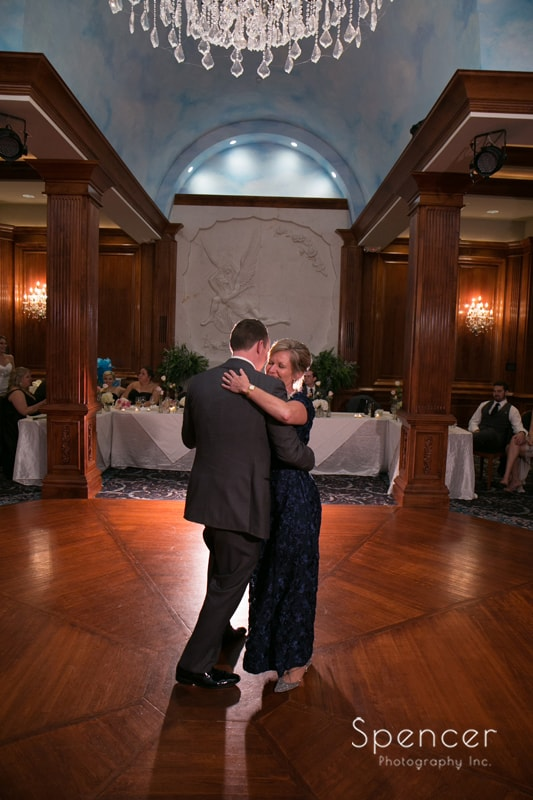 groom dancing with mom at La Pizzaria reception