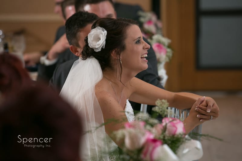 bride laughing during her wedding reception at st clair ballroom