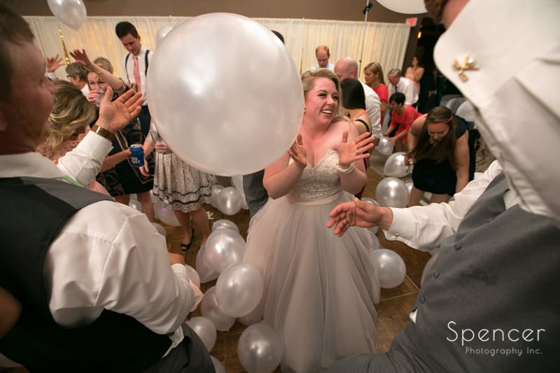 bride laughs after cleveland dj marion brothers drop balloons at her reception