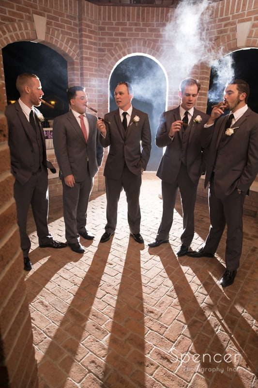 creative wedding night picture of groomsmen at La Pizzaria