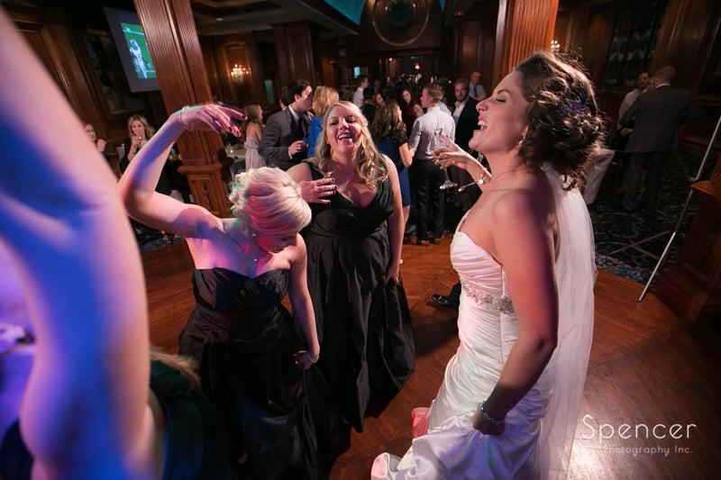 bride having fun at La Pizzaria wedding reception