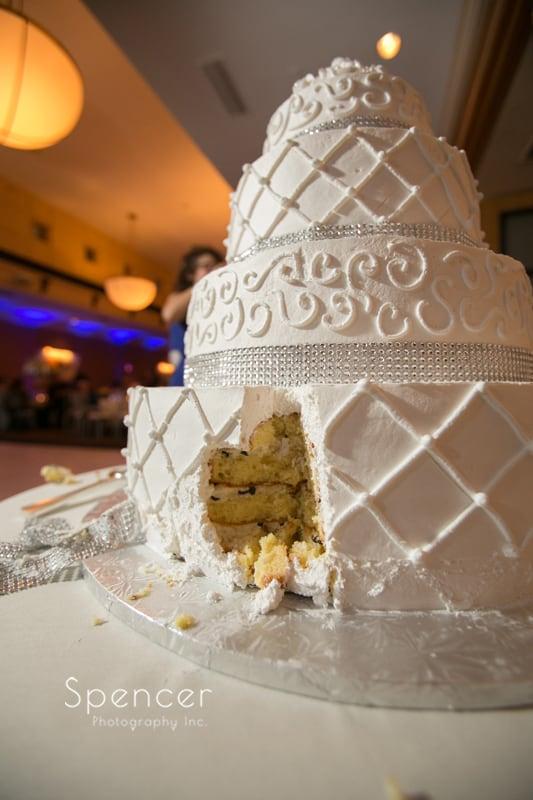 cut wedding cake at st clair ballroom wedding reception