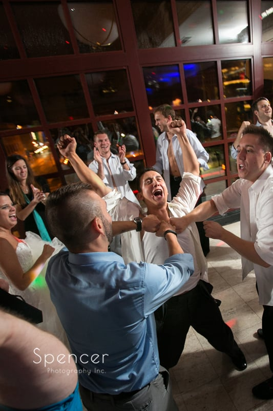 groom partying at wedding reception at st clair ballroom